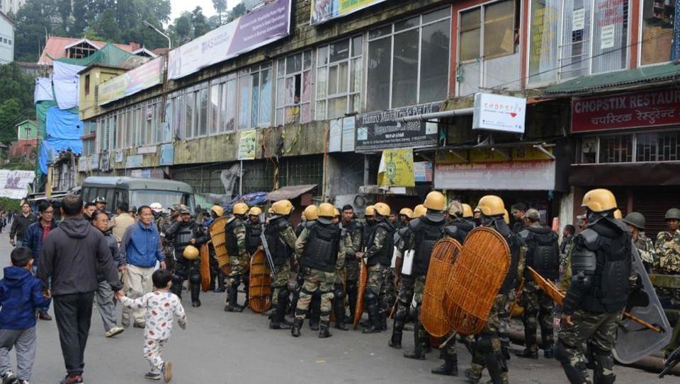 Police gather during an indefinite strike in Darjeeling on June 21, 2017.