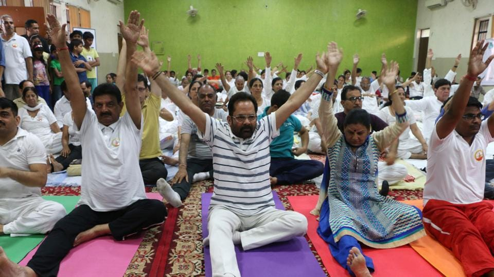 BJP leader Mukhtar Abbas Naqwi (centre) takes part in a yoga session held at Sector 50, Noida, onWednesday.
