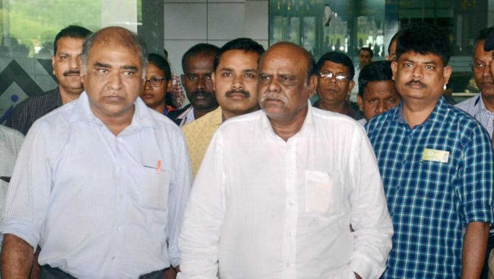 Former Calcutta High Court judge C S Karnan upon his arrival at the airport in Kolkata on Wednesday. Karnan, who was arrested from Coimbatore on Tuesday, more than a month after the Supreme Court sentenced him for contempt of court, was brought to Kolkata by a team of West Bengal Police.