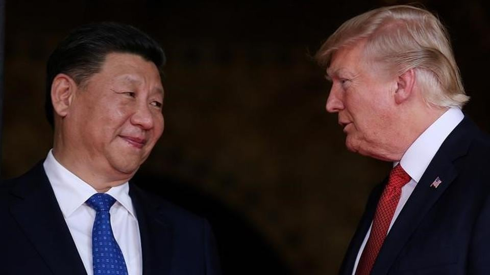 US President Donald Trump welcomes Chinese President Xi Jinping at Mar-a-Lago state in Palm Beach, Florida, US, April 6.