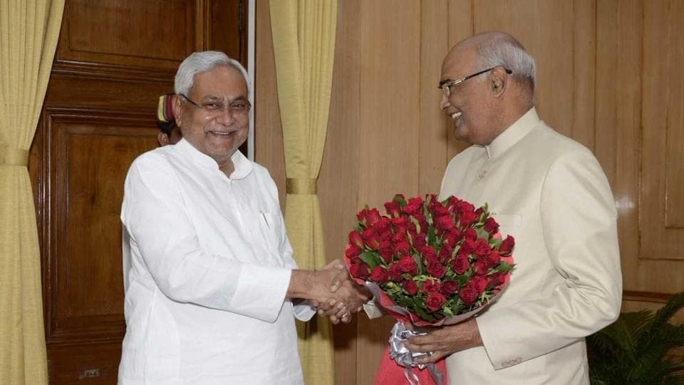 Bihar chief minister Nitish Kumar greets Bihar governor and NDA presidential nominee Ram Nath Kovind at governor's house in Patna on Monday.