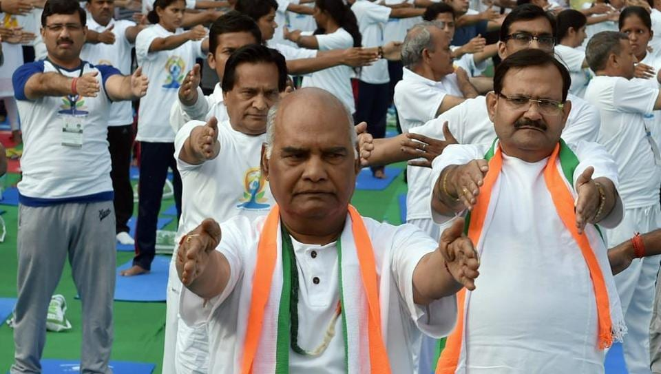 NDA candidate for President of India Ram Nath Kovind participates in a yoga session, to mark the 3rd International Yoga Day 2017, in Connaught Place area of New Delhi on Wednesday.