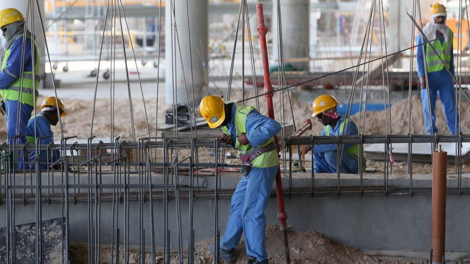 This file photo taken on October 03, 2013 shows migrant labourers working on a construction site in Doha in Qatar.