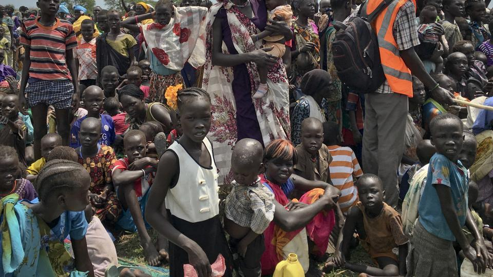 People line up to be registered with the World Food Programme (WFP) for food distribution in Old Fangak, in Jonglei state, one of the worst affected areas for food insecurity according to a food security report in South Sudan.  (AP)