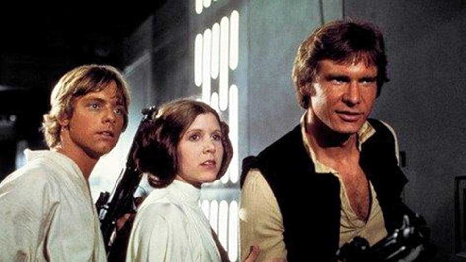 Mark Hamill (from left) as Luke Skywalker, Carrie Fisher as Princess Leia Organa and Harrison Ford as Hans Solo in the original 1977 Star Wars: Episode IV - A New Hope.