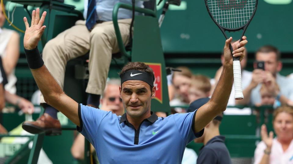 Roger Federer celebrates after the ATP Tennis matach against Japan's Yuichi Sugita in Halle.