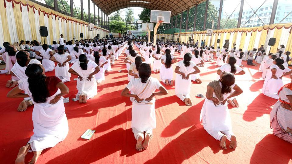 Participants seen mid-pose at an International Yoga Day event inaugurated by Kerala chief minister Pinarayi Vijayan at Central stadium in Thiruvananthapuram, Kerala. (Vivek R Nair/HT Photo)