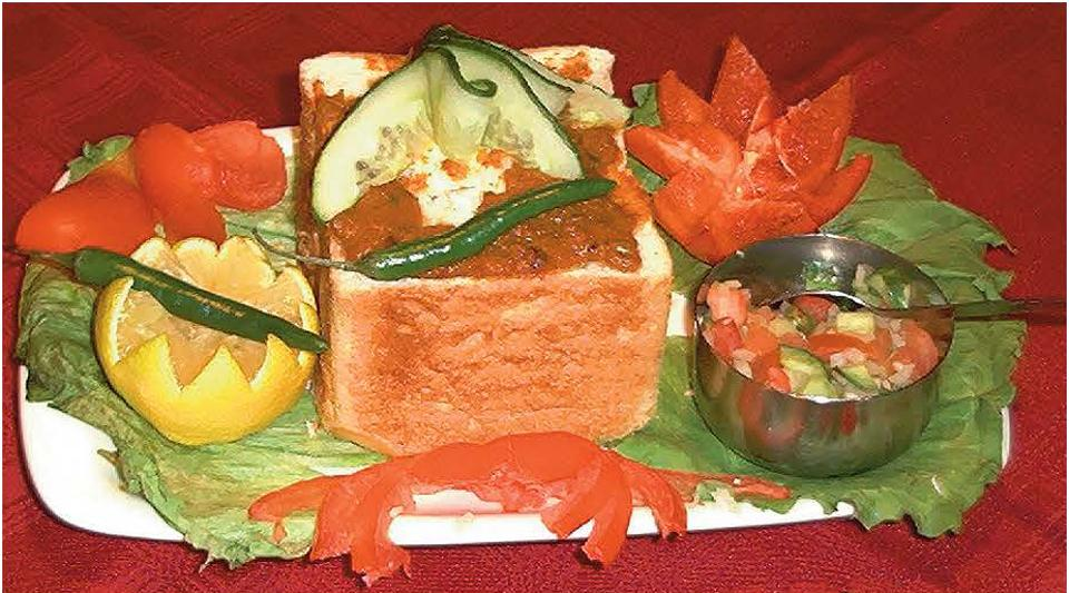 The most famous Indo-South African dish is bunny chow, a meat curry served in a hollowed out loaf of Western-style bread.
