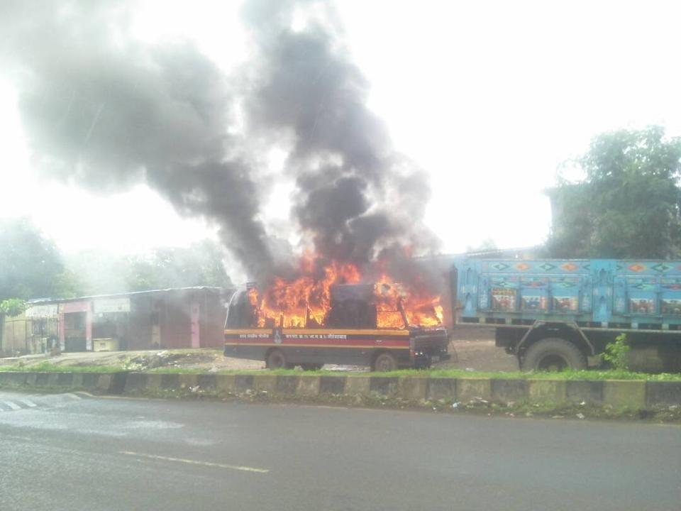 A police van that was set ablaze by farmers in Kalyan.