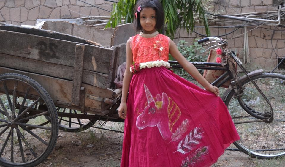 A child sports clothes painted and donated by 19-year-old Aanchal Sewani.