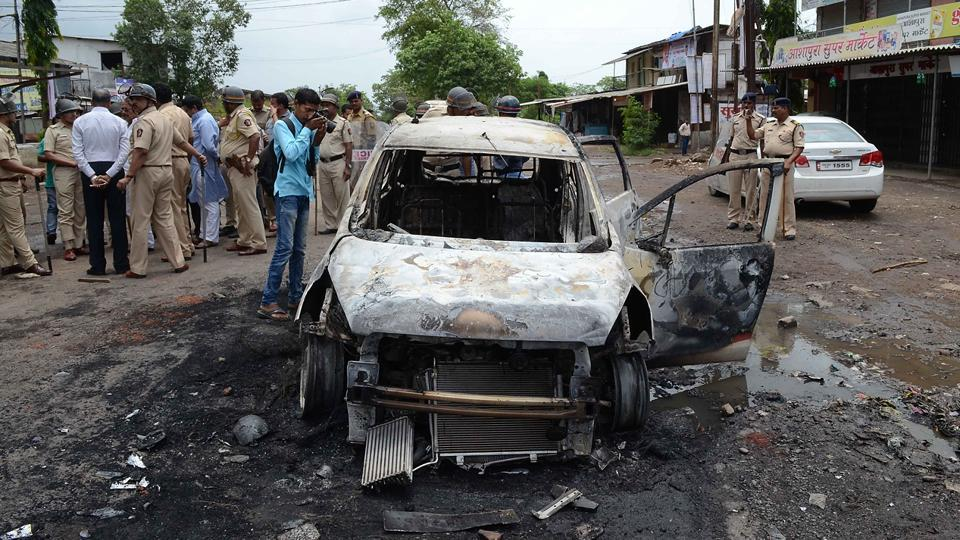 Cars, bikes, tyres, and even a police van with weapons were set on fire. (Rishikesh Choudhary/HT PHOTO)