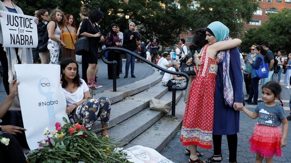 Attendees leaves flowers for Nabra Hassanen, a teenage Muslim girl killed by a bat-wielding motorist near a Virginia mosque, during a vigil in New York City, U.S. June 20, 2017.