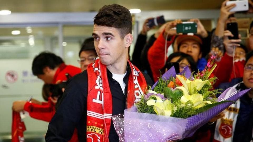 Brazilian international midfielder Oscar at the Shanghai Pudong International Airport.