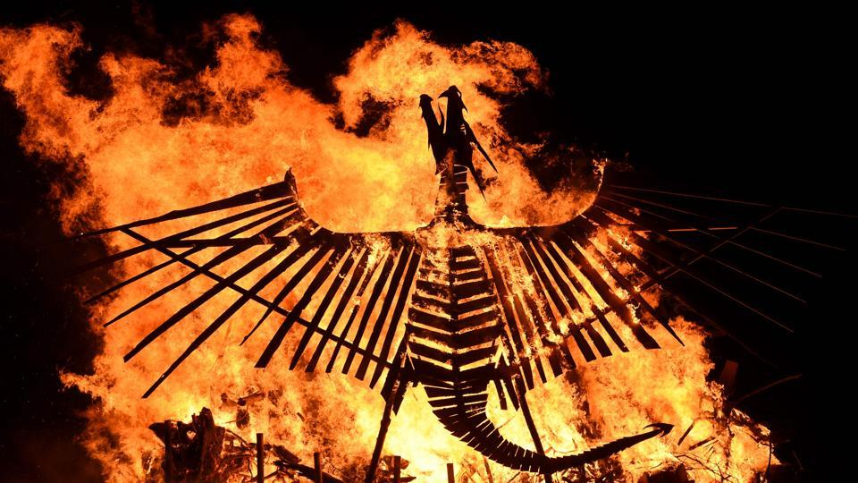 A bonfire featuring a large wooden phoenix burns at the Glastonbury Festival in Somerset, England.  (AFP)