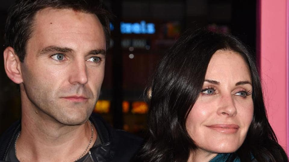Courteney Cox and musician Johnny McDaid attend a film premiere.