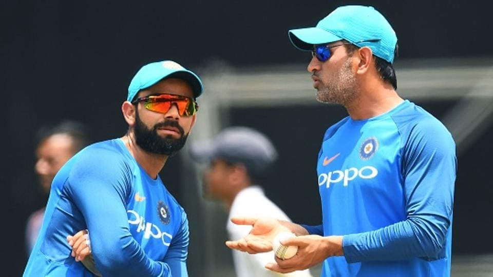 India's captain Virat Kohli (L) listens to teammate MS Dhoni during a practice session at the Queen's Park Oval in Port of Spain, Trinidad. (AFP/Getty Images)