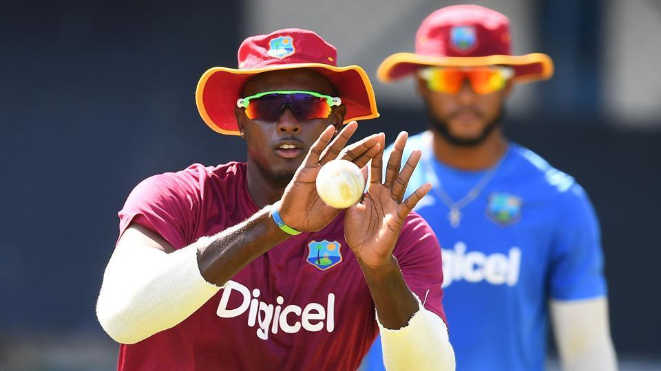 West Indies' captain Jason Holder grips a catch during a practice session. (AFP)