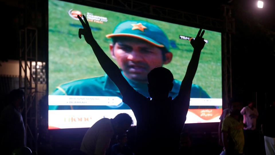 A man celebrates after Pakistan defeated India in the ICC Champions Trophy final.