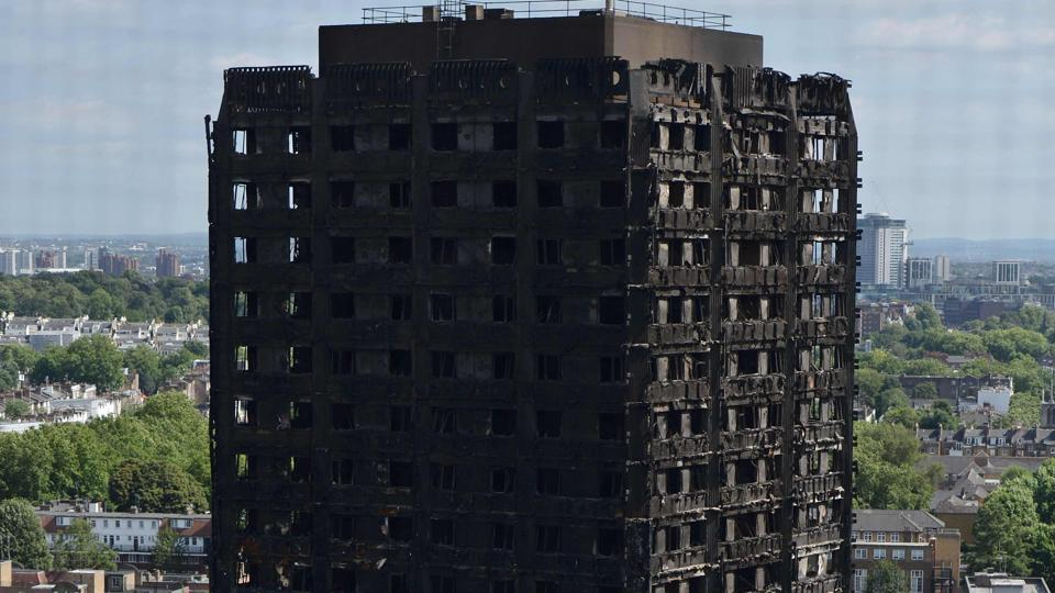 (FILES) This file photo taken on June 16, 2017 shows The remains of Grenfell Tower, a residential tower block in west London which was gutted by fire, are pictured on June 16, 2017. Combustible cladding has been found in