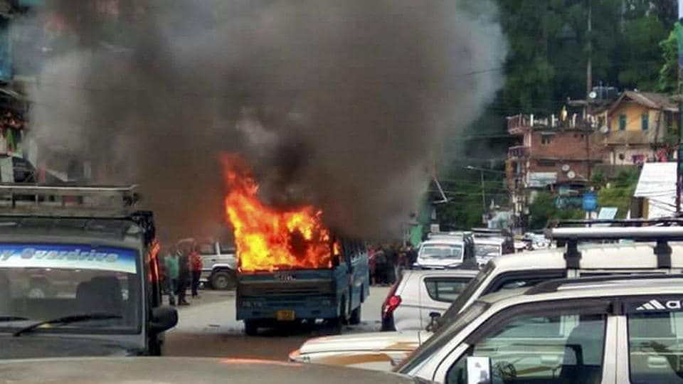 A state-government bus in flames after it was torched by Gorkha Janmukti Morcha (GJM) supporters in Darjeeling on Thursday.