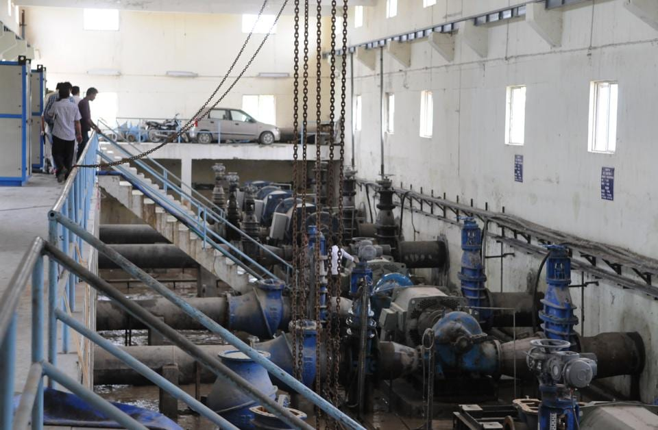 Huda engineers inspect pipelines at the Chandu Budhera water treatment plant on Thursday.