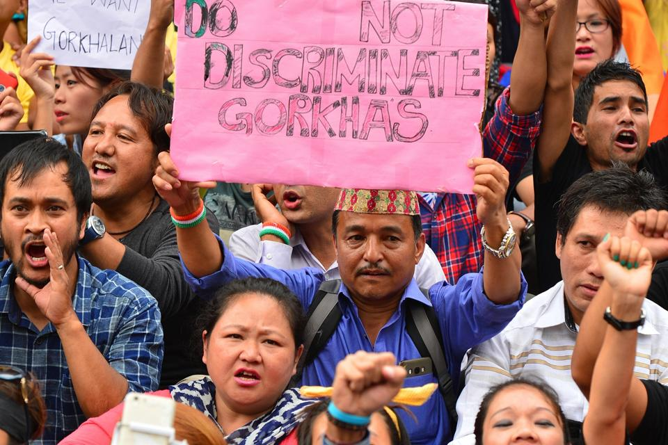 Indian members of the Gorkha community hold placards and shout slogans during a demonstration demanding a separate