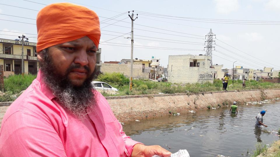 A local resident showing the torn Gutka Sahib page.