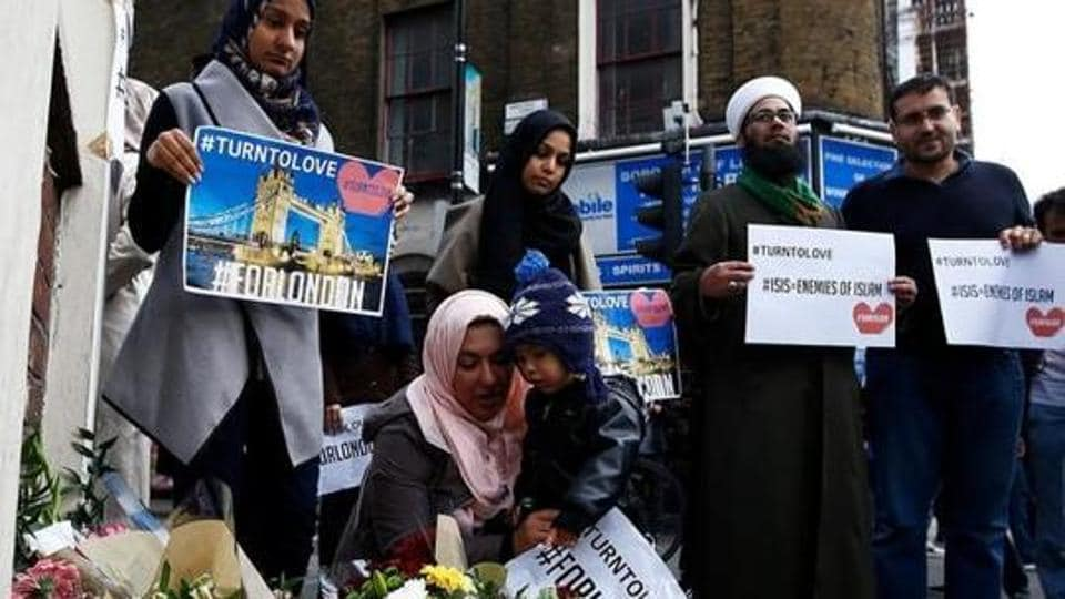 Muslims pray at a floral tribute near London Bridge, after attackers rammed a hired van into pedestrians on London Bridge and stabbed others nearby killing and injuring people, in London, Britain June 4, 2017.
