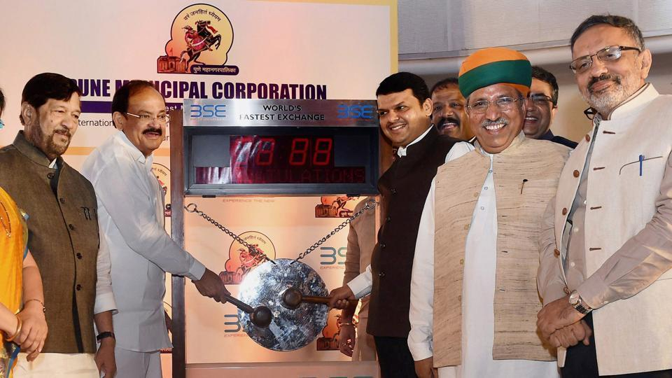 (From left)Maharastra cabinet minister Girish Bapat, Union minister Venkaiah Naidu, Maharashtra chief minister Devendra Fadnavis, minister of state for finance Arjun Ram Meghwal and Urban Development Secretary Rajiv Gauba at the launch at Bombay Stock Exchange (BSE) in Mumbai on Thursday.