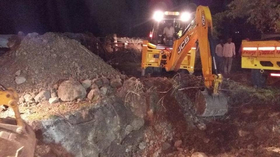 A JCB digs a parallel well adjacent to the one Veena fell into in Ikkareddygudem village of Chevella block in Rangareddy district in Telangana on Thursday evening.