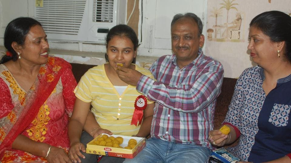 Parents of Nikita Goyal (girl in yellow shirt) and her well wishers celebrating in Bathinda after she secured AIR8 in CBSENEET2017, an all-India examination for admission to medical and dental colleges.