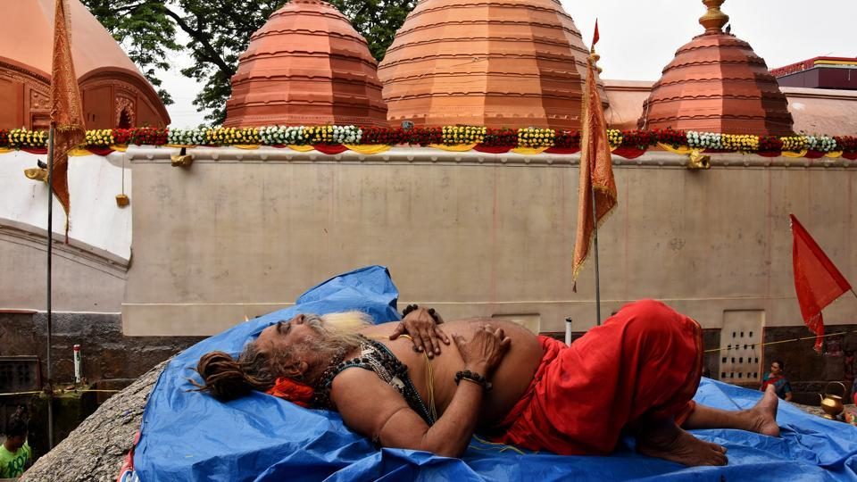 A Sadhu or a Hindu holy man sleeps inside the Kamakhya temple during the annual Hindu festival of Ambubachi.  (REUTERS)