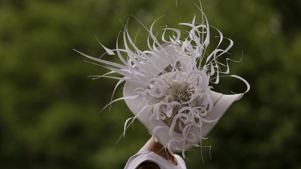 Barbra Studwick wears a white and feather ornate hat on the third day of the Royal Ascot horse race. (Alastair Grant / AP)