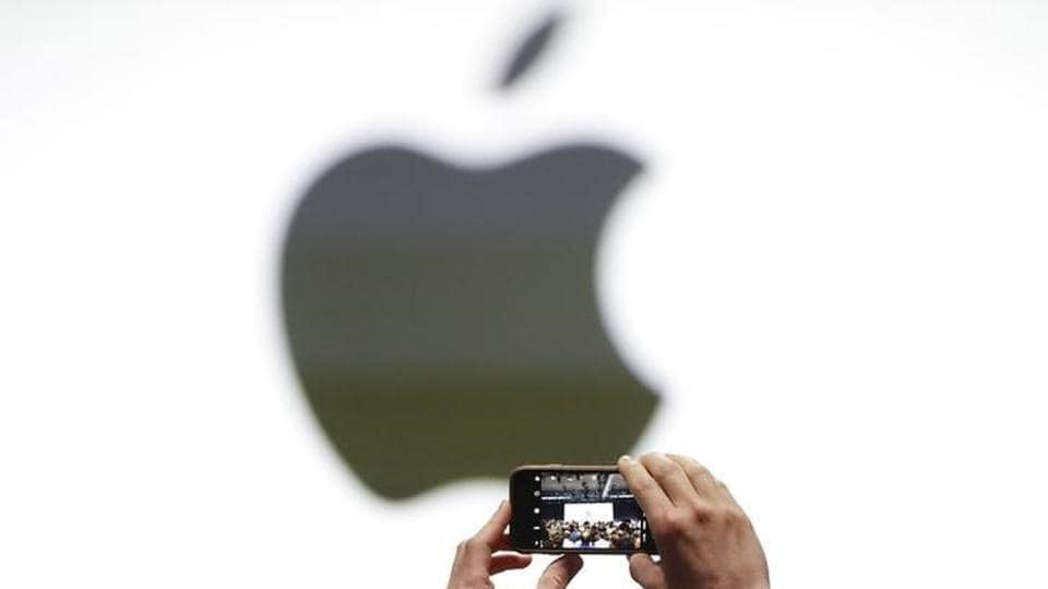An audience member takes a photo of the Apple logo before the start of the company's annual developer conference in San Jose, California.