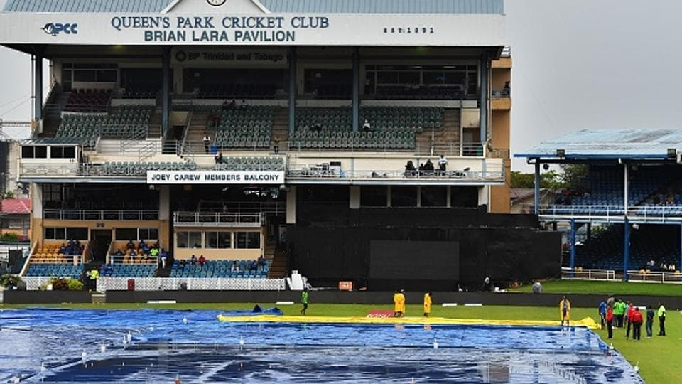 Match officials inspect the wet field as rain interrupt play of the first One Day International (ODI) match between West Indies and India. Catch full cricket score of India vs West Indies 2017, 1st ODI here