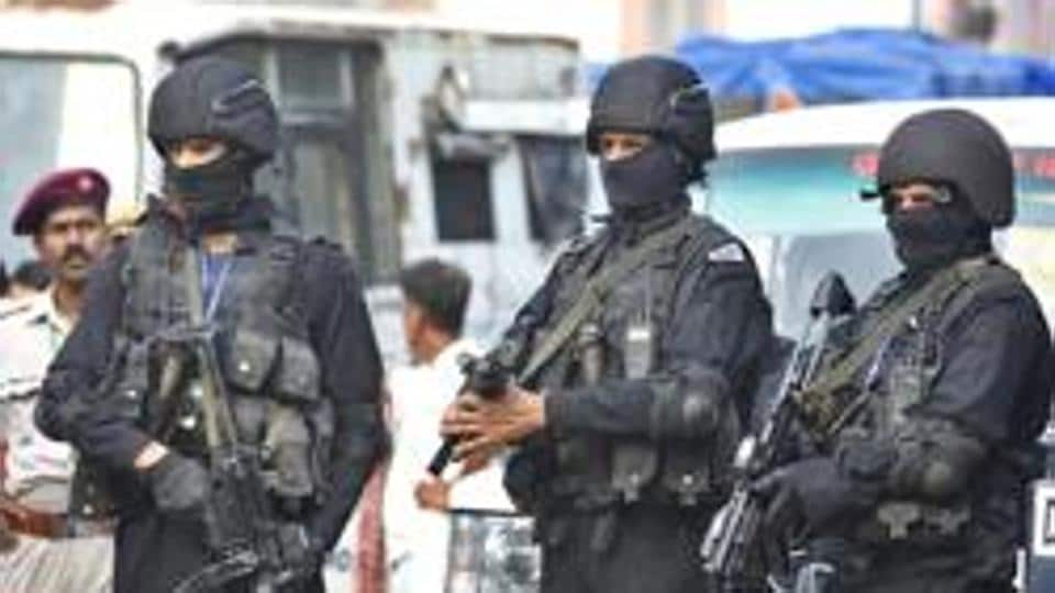 NSG Commandos on alert during the final rehearsal for the Independence Day celebrations at the Red Fort in New Delhi.