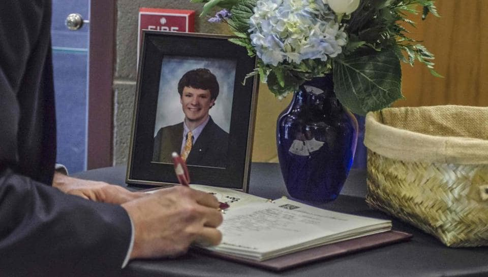 A mourner signs a guest book in Wyoming, Ohio, during the funeral for Otto Warmbier.