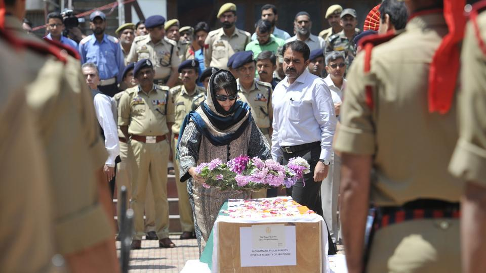 Jammu and Kashmir Chief Minister Mehbooba Mufti lays a wreath on the coffin of deputy superintendent of police Mohammad Ayoub Pandith, police headquarters, Srinagar, June 23
