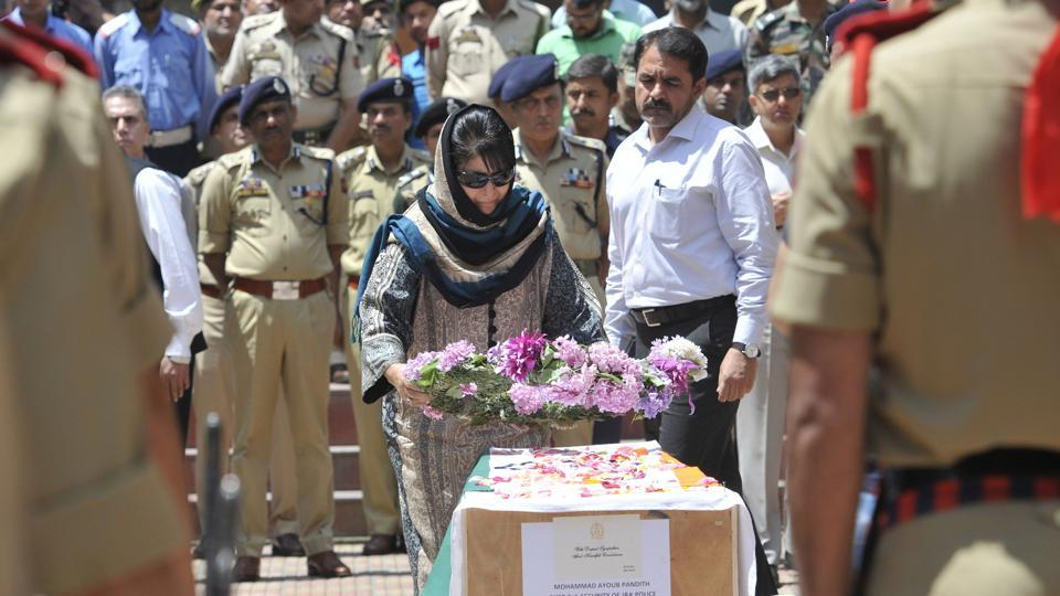 Jammu and kashmir chief minister Mehbooba Mufti lays wreath on the coffin of deputy superintendent of police Mohammad Ayub Pandith who was lynched by a mob in Srinagar on Friday.