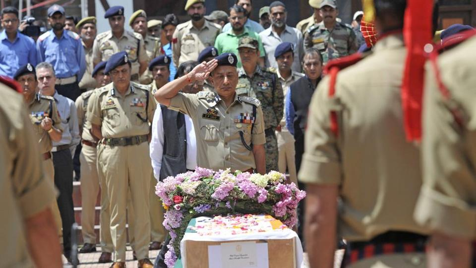Director General of Jammu and Kashmir Police S P Vaid salutes during the wreath-laying ceremony for Mohammed Ayub Pandit in Srinagar.
