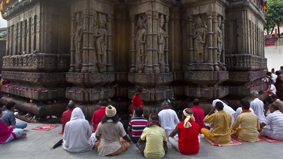 People gather to pray at the Kamakhya temple on the occasion of Ambubachi Mela in Guwahati,India. The temple is closed till Sunday to celebrate the yearly menstruation course of goddess Kamkhya. Sadhus' and devotees from all over the country and abroad have arrived at the temple atop the Nilachal Hills with the district administration making elaborate arrangements to ensure smooth functioning of the festival.  (AP)