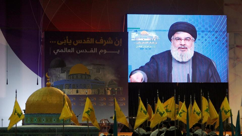 Lebanon's Hezbollah leader Sayyed Hassan Nasrallah addresses his supporters via a screen during a rally marking Al-Quds day in Beirut's southern suburbs, Lebanon June 23, 2017.