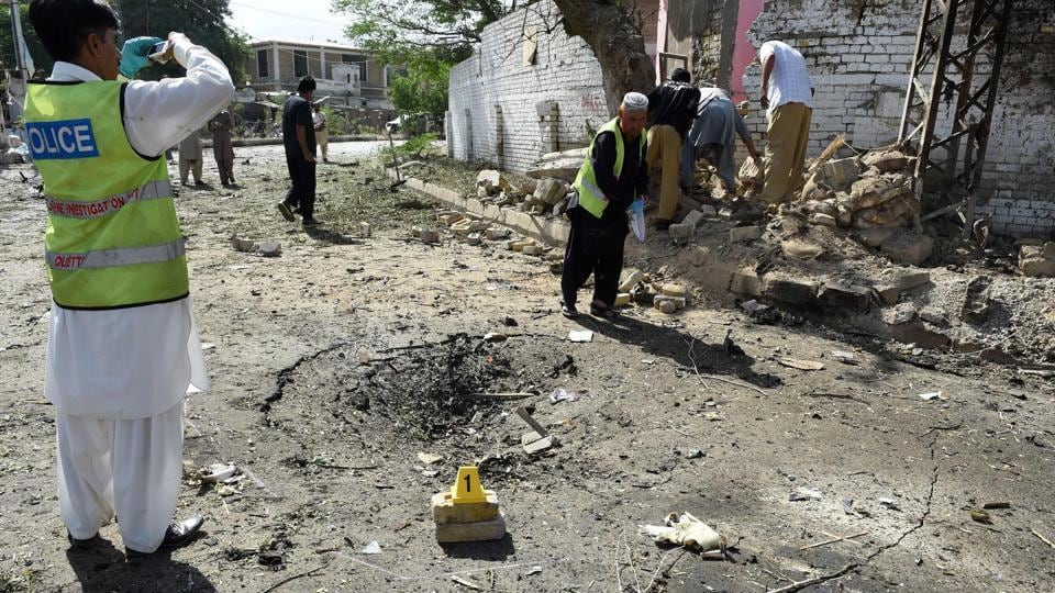 Pakistani police inspect the site of a powerful explosion that targeted a police vehicle in Quetta.