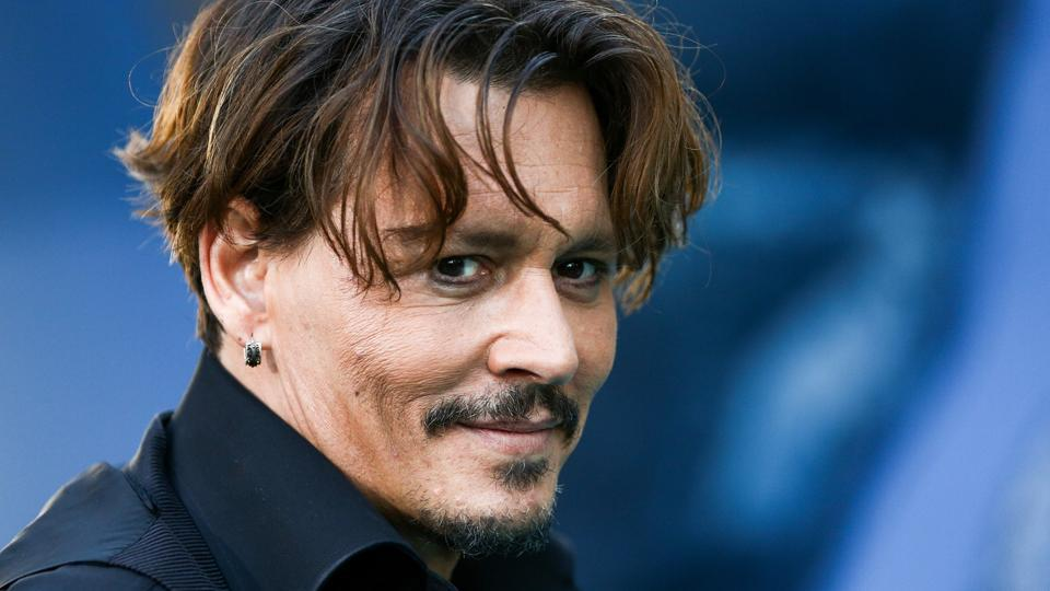 Johnny Depp attends the premiere of Disney's Pirates Of The Caribbean: Dead Men Tell No Tales in California.