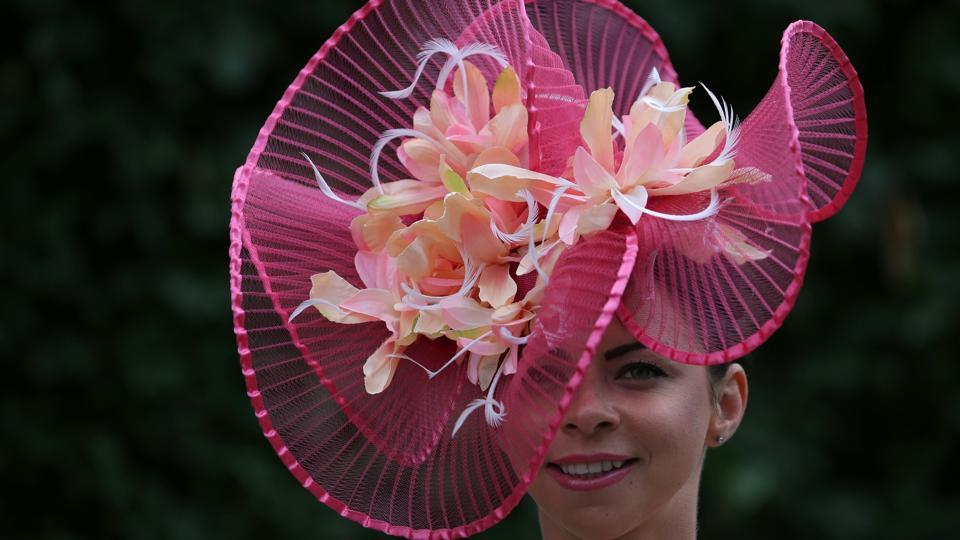Racegoers are encouraged to make a special effort with their outfits for Ladies' Day, which is as much a social occasion as a major sporting event for top owners, trainers and jockeys. (Daniel LEAL-OLIVAS / AFP)