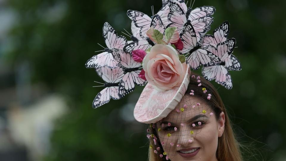 Racegoers attend Ladies Day at the Royal Ascot horse racing meet, in Ascot, west of London. (Daniel LEAL-OLIVAS / AFP)