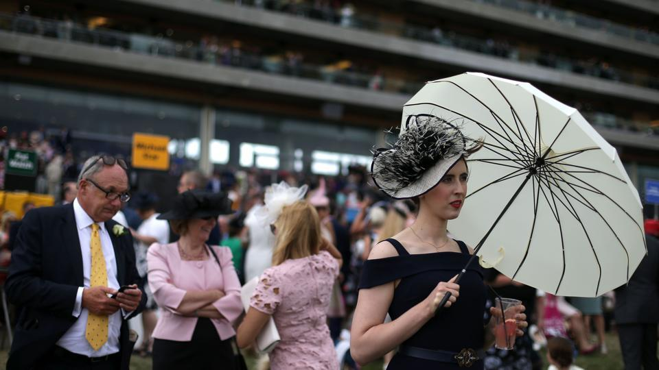 The stands were full of vibrant hats as racegoers donned their glad rags for the prestigious event. (AFP)