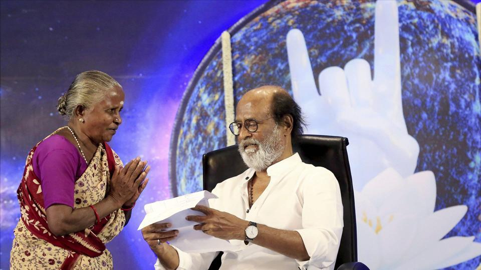 Chennai: Tamil superstar Rajinikanth meeting with a fan in Chennai on Thursday. PTI Photo (PTI5_19_2017_000120A)
