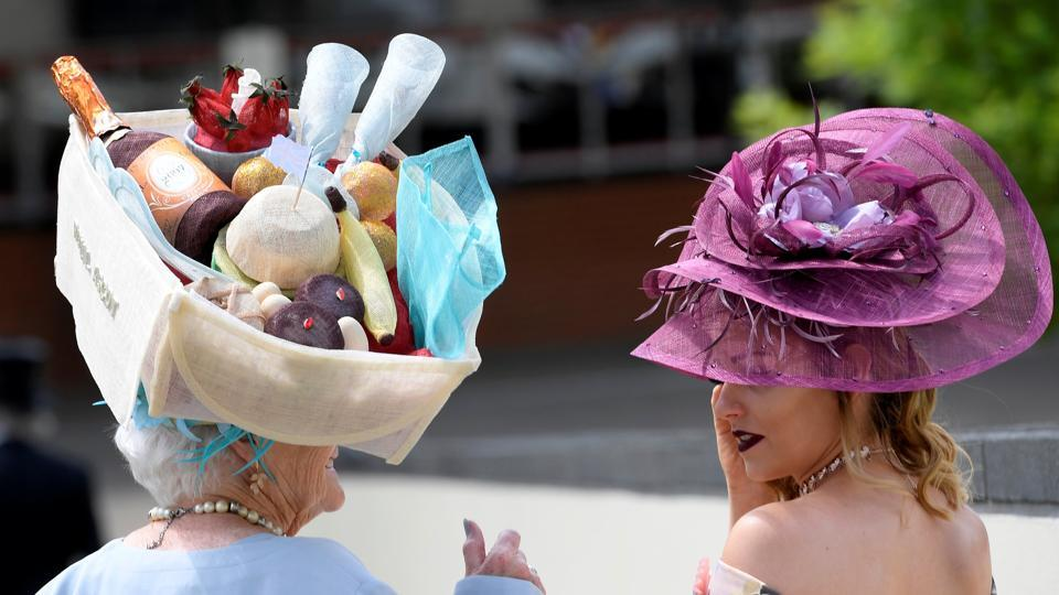 Racegoer Anne Hudson from St. Helens wears a hat shaped like a picnic basket. (Toby Melville / Reuters)
