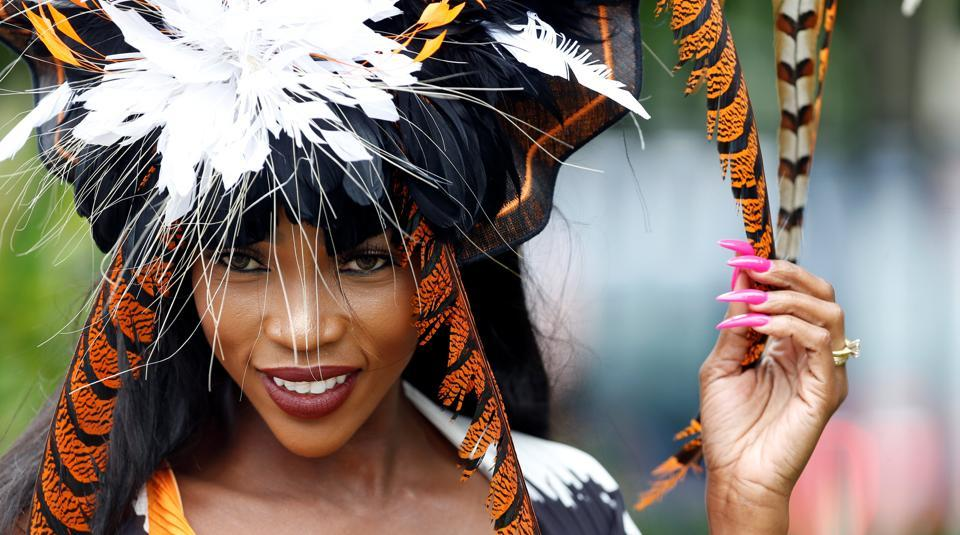 A racegoer poses during Ladies Day at Ascot. Ascot Racecourse was founded in 1711 by Queen Anne. (Action Images via Reuters)